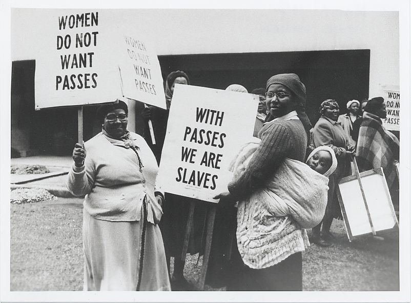 A group of women hold signs in demonstration against the pass laws in Cape Town on August 9, 1956.