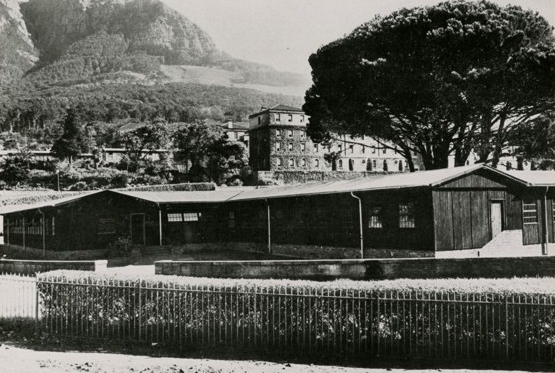 Photo of first Architecture Library occupied in two wooden huts on the Upper Campus sports fields