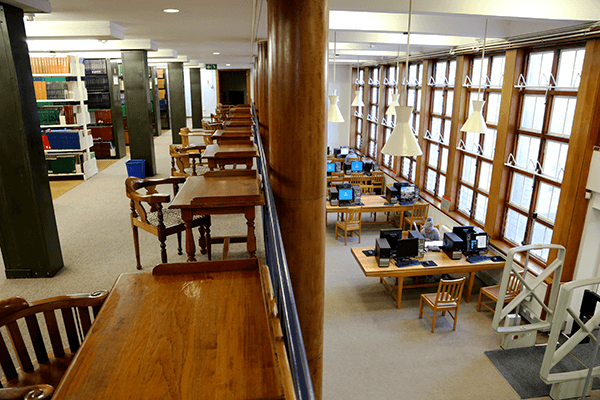 Upstairs seating overlooking main reading room with desks and PCs at Health Sciences Library