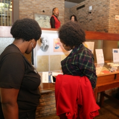 Visitors looking athe the Special Collections displays at Baxter Theatre